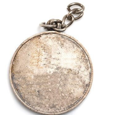 old medal on white background photo
