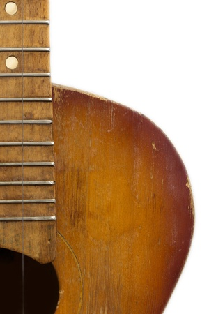 western culture: old wooden guitar on a white background