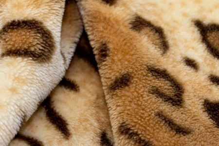 background from a fabric tiger skin photo