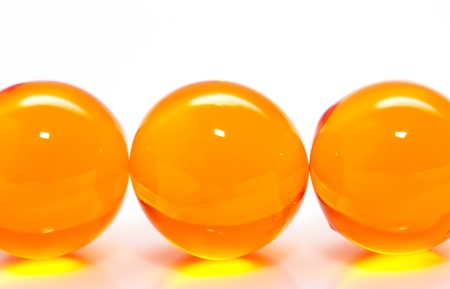 ball of fish oil on a white background. macro photo