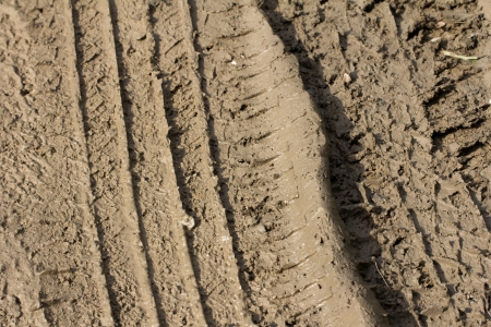 track from a car tire on the clay photo