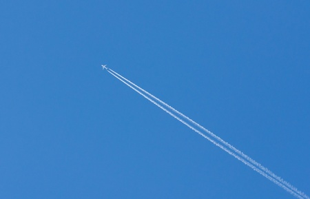 airfoil: plane is flying on a blue sky