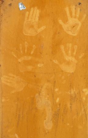 hand prints on an orange background photo