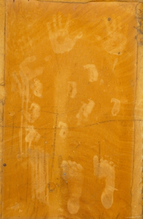 hand and foot prints on an orange background photo