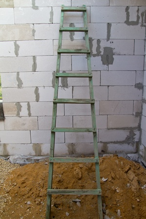 ascends: stairs near brick wall