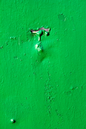 metal background painted with green paint photo