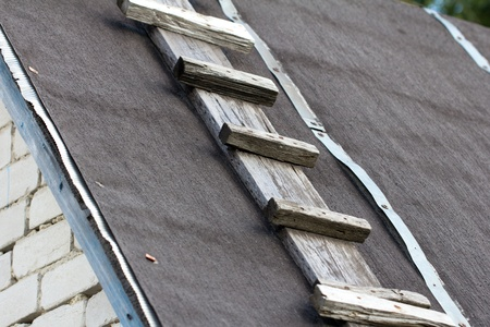 rungs: wooden staircase to the roof Stock Photo