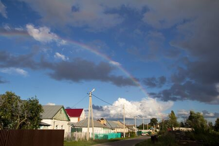 rainbow in the sky in the village photo