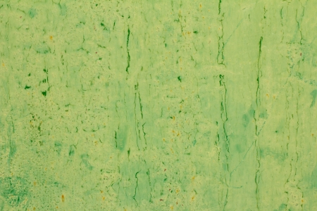 abstract background of old green paint on the metal surface photo