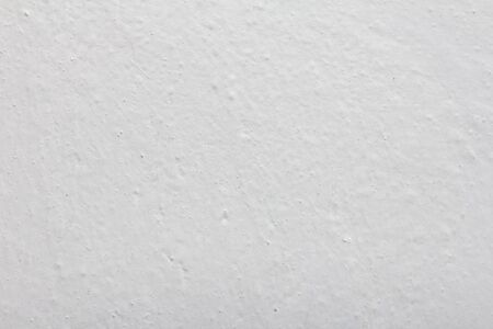 background of a white wall painted with lime photo