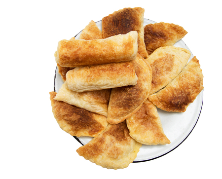 fresh tasty meat pies on a white background photo