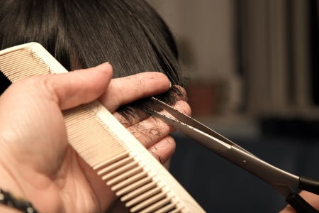 Men's haircut at the barber scissors photo