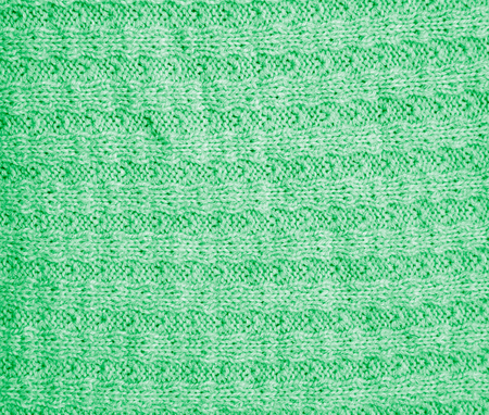 background of a green knitted fabric. texture photo