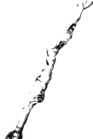 a jet of water on a white background photo