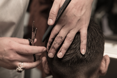 barber scissors: Mens haircut at the barber scissors Stock Photo