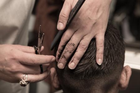 shop skill: Mens haircut at the barber scissors Stock Photo