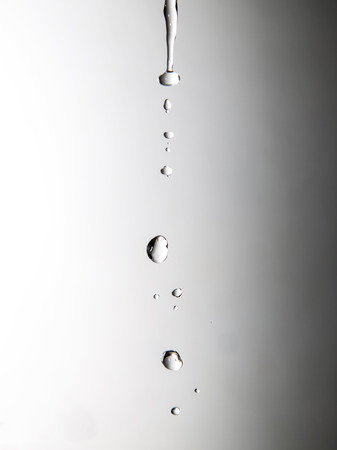 a jet of water on a gray background Stock Photo - 24103299