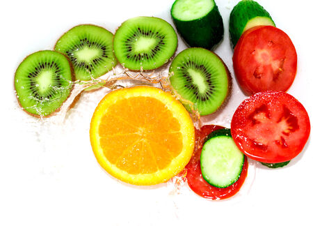fresh fruits and vegetables in water on a white background photo