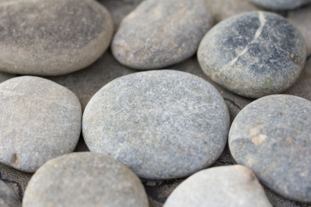 beachcomb: handful of stones Stock Photo