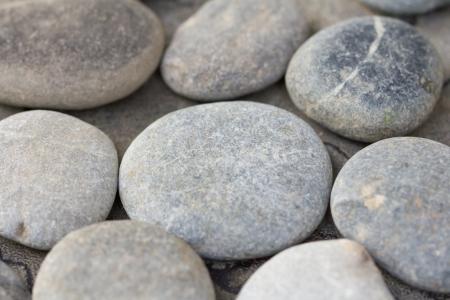 beachcomb: handful of stones Stock Photo