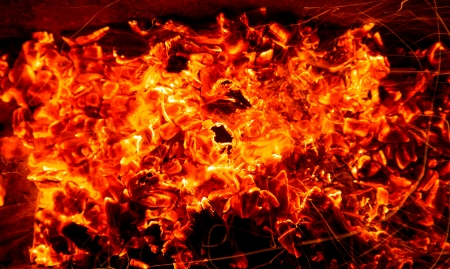 abstract background of burning coals of fire with sparks