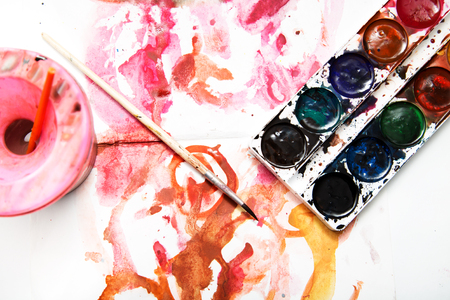 painting watercolor paint on white paper photo