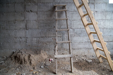 ascends: wooden staircase near concrete wall