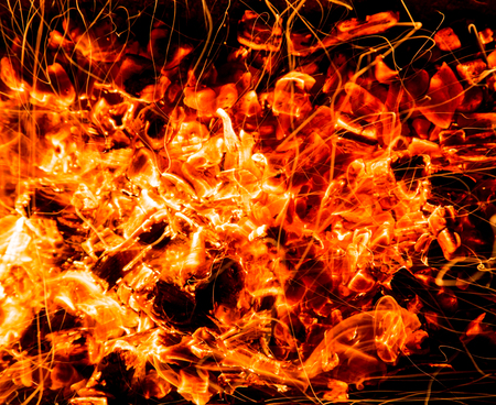 abstract background. burning charcoals with sparks photo