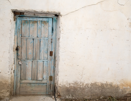 old wooden door on a white wall photo