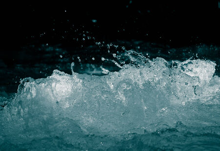 rough water on a black background photo