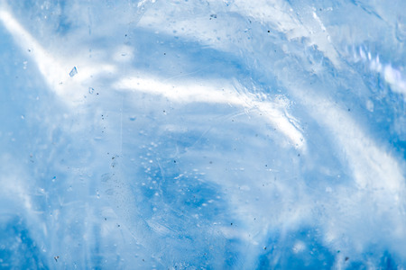 background of blue ice. Macro photo