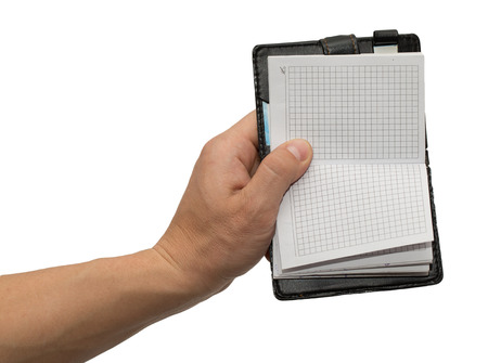 notebook in hand on white background photo