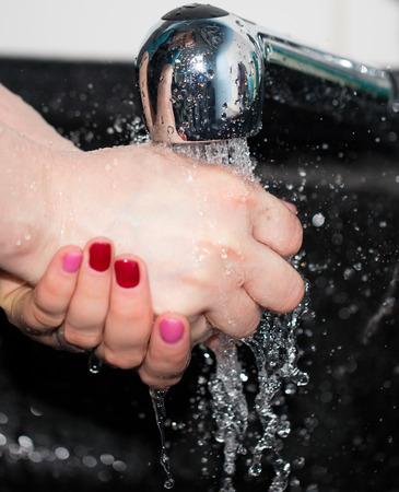 handwashing: hand washing with tap water