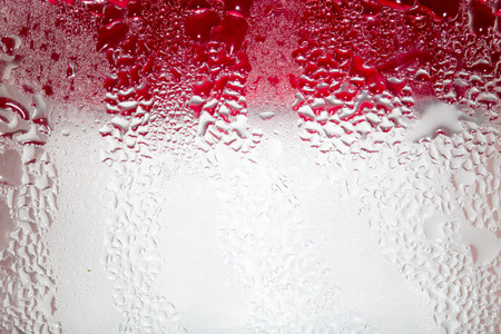 Abstract background of water drops on a red background