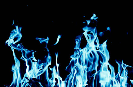 gas fireplace: abstract background of blue flame fire on black background