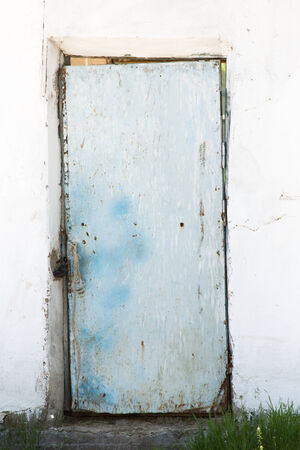 old door on a white wall