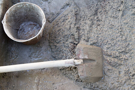 cement solution: cement solution with a shovel Stock Photo