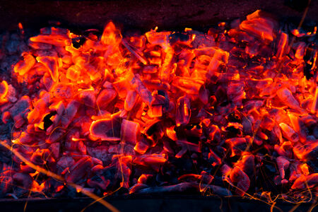 swelter: Campfire with burning firewood on foreground closeup Stock Photo