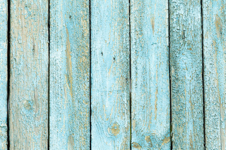 flaky: wooden background with old blue paint