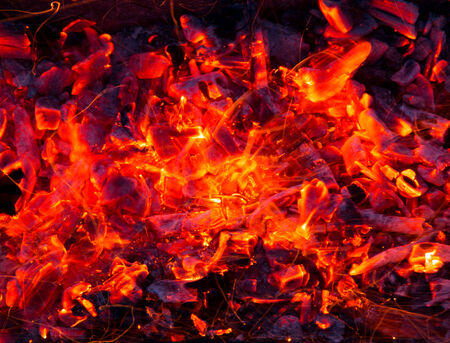 oxidation: Campfire with burning firewood on foreground closeup Stock Photo