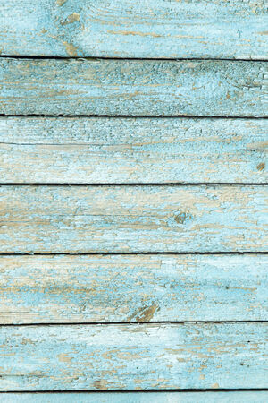 chipping: wooden background with old blue paint