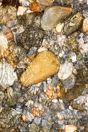 crystalline gold: Background of water and stone Stock Photo