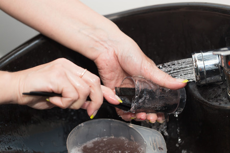 washing dishes in water photo