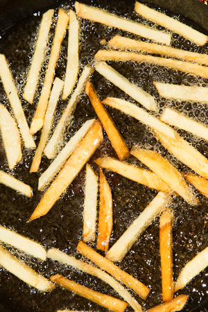 French fries are fried in a pan photo
