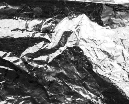 crumpled silver foil as a background photo