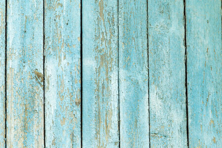 wooden background with old blue paint photo
