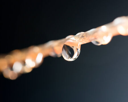 drops of water on a rope. macro photo