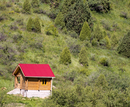 wooden cabin in the mountains of Tien Shan Stock Photo