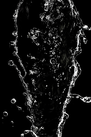 pouring water: spray water on a black background Stock Photo