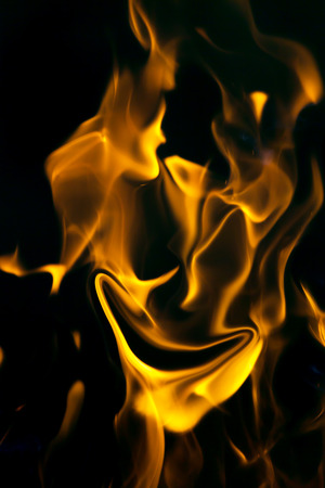 demoniacal: face on fire on a black background Stock Photo